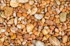 橙色小卵石石头纹理背景 库存照片