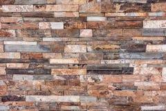 橙色岩石分层堆积纹理背景的墙壁 图库摄影