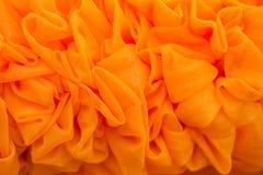 橙色帷幕做了花 库存照片