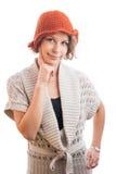 橙色帽子的少妇 库存照片