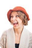 橙色帽子的少妇 免版税库存照片