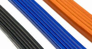橙色彩色塑泥,蓝色和黑色3个的片断  图库摄影
