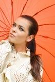橙色性感的伞妇女 图库摄影