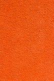 橙色意大利灰泥墙壁纹理背景 免版税库存照片