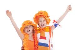 橙色成套装备欢呼的两个女孩 库存图片