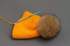 橙色手工制造帽子 免版税图库摄影