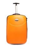 橙色手提箱旅行 免版税库存照片
