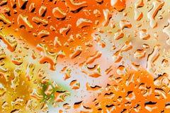 橙色抽象水滴背景 免版税库存照片