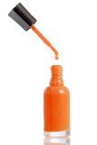 橙色指甲油水滴 免版税库存图片