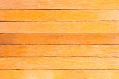 橙色木盘区背景,纹理的抽象板条 库存图片
