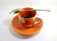 橙色杯子用咖啡 库存照片