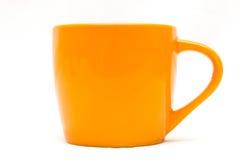 橙色杯子 库存照片