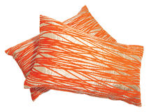 橙色枕头银投掷窍门 免版税库存图片