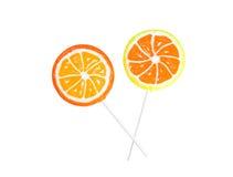 橙色查出的柠檬的棒棒糖 库存照片