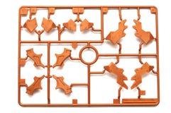 橙色棕色塑料比例模型成套工具片断设置了与未来派机器人零件 免版税图库摄影