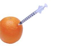 橙色注射器 库存照片