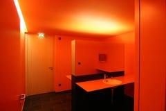 橙色洗手间 库存图片