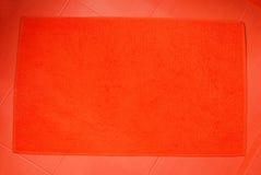 橙色浴室防滑垫 免版税库存照片