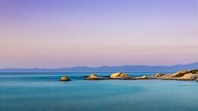 橙色海滩黄昏 免版税库存照片