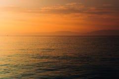 橙色海洋日落 免版税库存图片