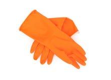橙色清洗的颜色橡胶手套在白色背景, hou 免版税库存照片
