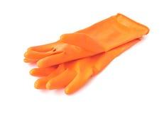 橙色清洗的颜色橡胶手套在白色背景, hou 库存照片