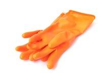 橙色清洗的颜色橡胶手套在白色背景, hou 免版税图库摄影