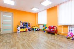 橙色游戏室在幼儿园 免版税库存照片