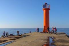 橙色灯塔在晴天 免版税库存照片