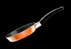 橙色煎锅 免版税库存图片