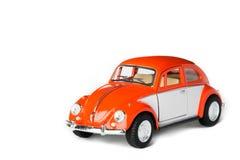 橙色玩具汽车 库存照片