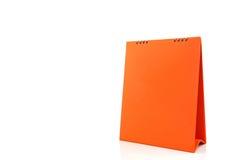 橙色白纸书桌螺旋日历 免版税库存图片