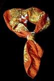 橙色白色在黑背景的一条黄色丝绸围巾 库存图片