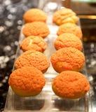 橙色的杯形蛋糕 库存照片