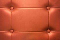 橙色皮革背景纹理 免版税库存图片