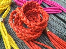 橙色皮革绳索转弯传送带 库存照片