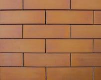 橙色砖墙或背景 免版税库存图片