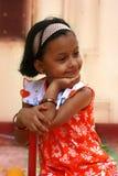 橙色礼服的亚裔女孩 库存图片