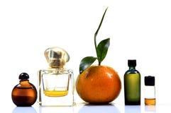橙色精华和香水 免版税库存照片
