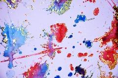 橙色紫罗兰闪耀的蓝色斑点,蜡状的背景,创造性的设计 图库摄影