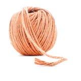 橙色纤维线团,钩针编织在白色背景隔绝的螺纹球 免版税库存照片