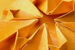橙色纸花结构  免版税库存图片