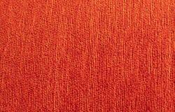 橙色纺织品沙发背景 免版税库存图片
