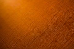 橙色纺织品纹理背景 库存照片