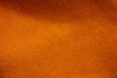 橙色织品背景的纹理 库存照片