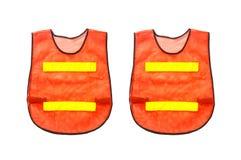 2橙色背心,隔绝在白色和裁减路线 库存照片