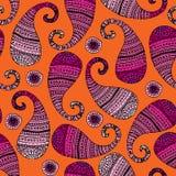 橙色背景的桃红色佩兹利 库存照片