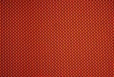 橙色背景的电池 免版税图库摄影