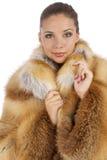 橙色自然外套的女孩 免版税库存图片