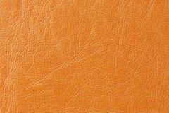 橙色虚假皮革背景纹理 图库摄影